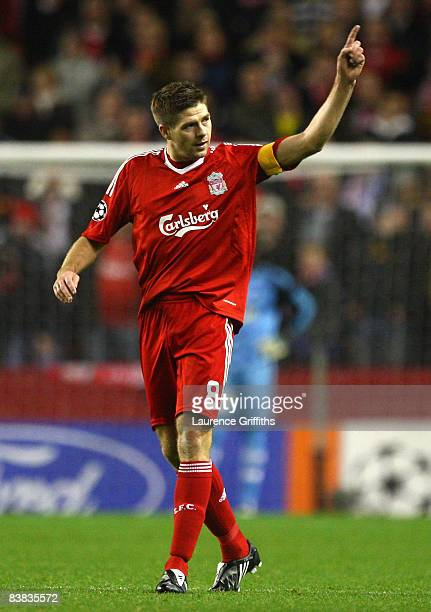 Steven Gerrard of Liverpool celebrates scoring the opening goal during the UEFA Champions League Group D match between Liverpool and Marseille at...