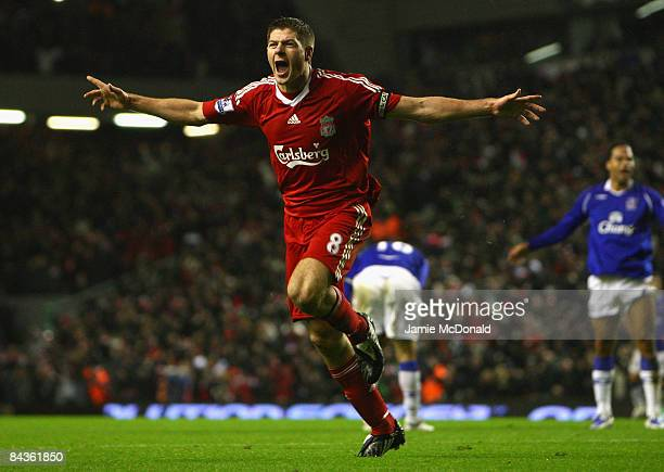Steven Gerrard of Liverpool celebrates scoring the opening goal during the Barclays Premier League match between Liverpool and Everton at Anfield on...