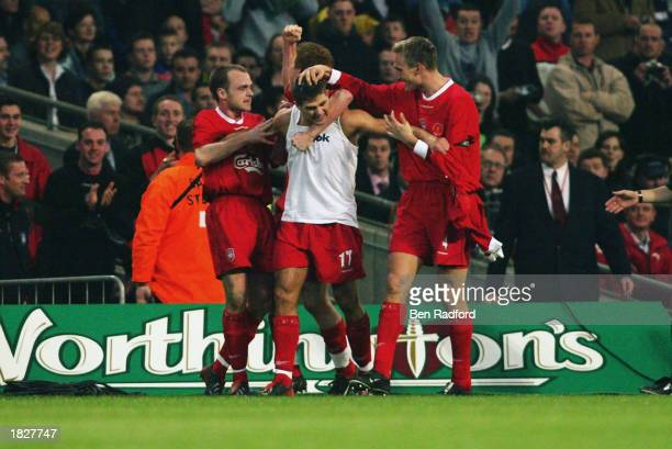 Steven Gerrard of Liverpool celebrates scoring the opening goal with team-mates Danny Murphy, John Arne Riise and Sami Hyypia during the Worthington...