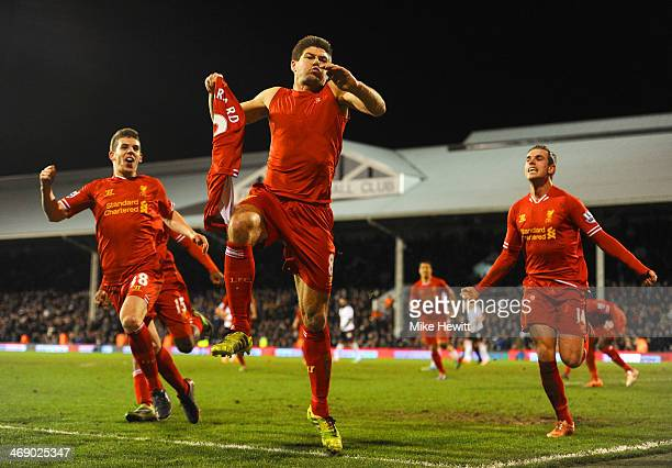 Steven Gerrard of Liverpool celebrates scoring their third goal from the penalty spot during the Barclays Premier League match between Fulham and...