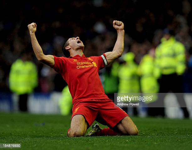 Steven Gerrard of Liverpool celebrates the disallowed goal of Luis Suarez of Liverpool during the Barclays Premier League match between Everton and...