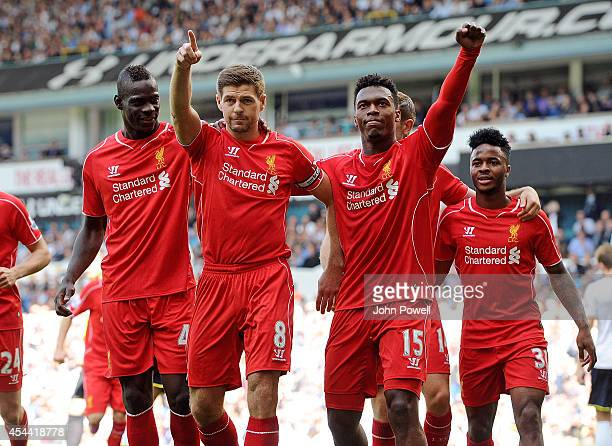 Steven Gerrard of Liverpool celebrates with Daniel Sturridge and Mario Balotelli after scoring from the spot during the Barclays Premier League match...