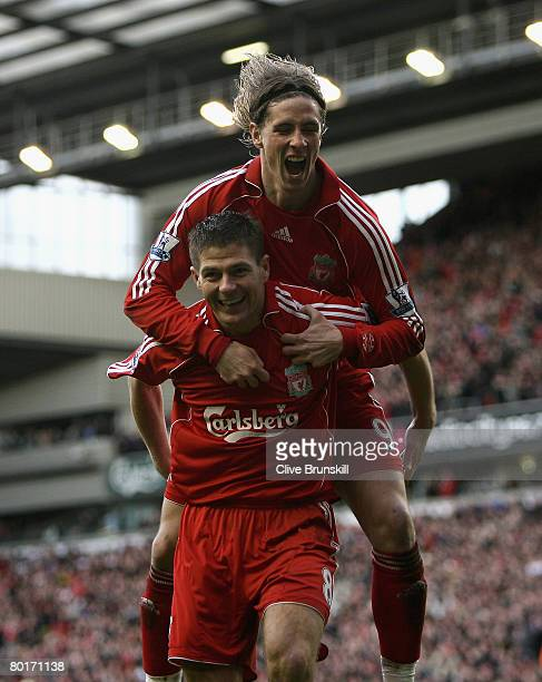 Steven Gerrard of Liverpool celebrates with Fernando Torres after scoring the third goal during the Barclays Premier League match between Liverpool...