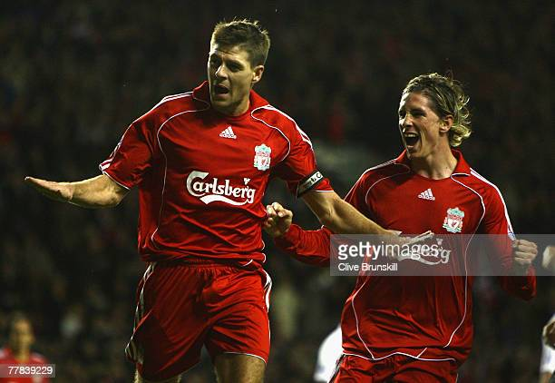 Steven Gerrard of Liverpool celebrates with Fernando Torres of Liverpool after scoring his team's second goal during the Barclays Premier League...