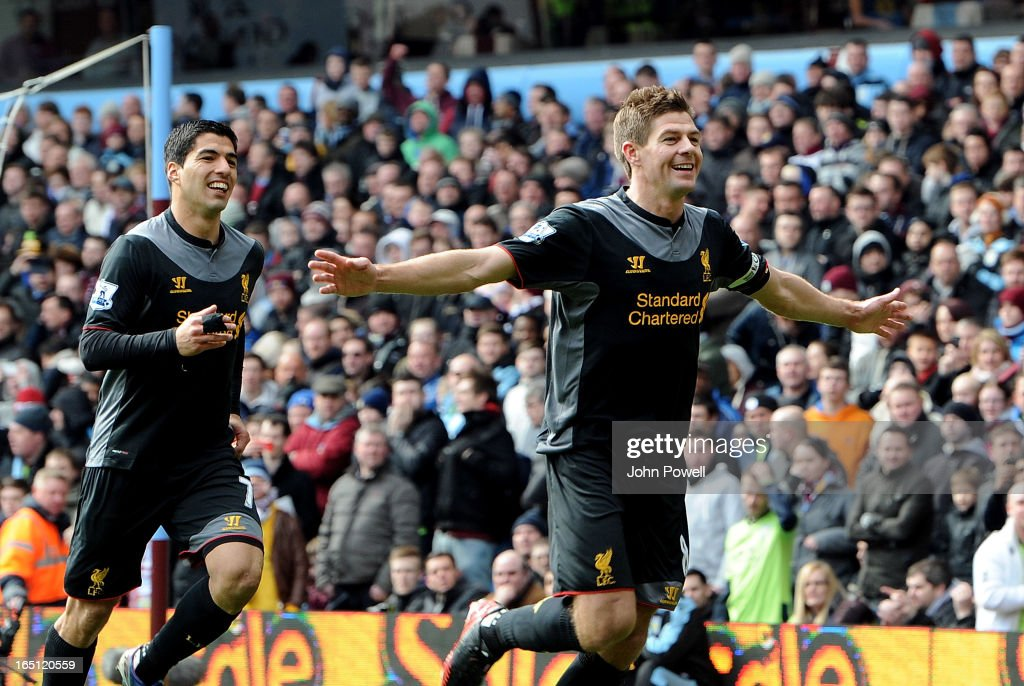 Steven Gerrard (R) of Liverpool celebrates with his team-mate Luis Suarez after scoring their second goal from the penalty spot during the Barclays Premier League match between Aston Villa and Liverpool at Villa Park on March 31, 2013 in Birmingham, England.