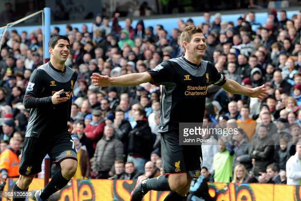 Steven Gerrard of Liverpool celebrates with his team-mate Luis Suarez after scoring their second goal from the penalty spot during the Barclays...