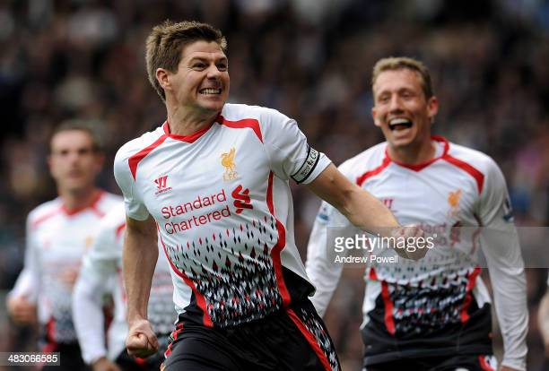 Steven Gerrard of Liverpool celebrates with his teammates after scoring their second goal from the penalty spot during the Barclays Premier League...