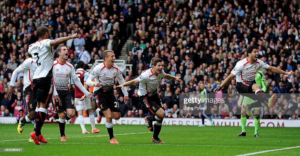 Steven Gerrard of Liverpool celebrates with his team-mates after scoring the second goal from the penalty spot during the Barclays Premier League match between West Ham United and Liverpool at Boleyn Ground on April 6, 2014 in London, England.