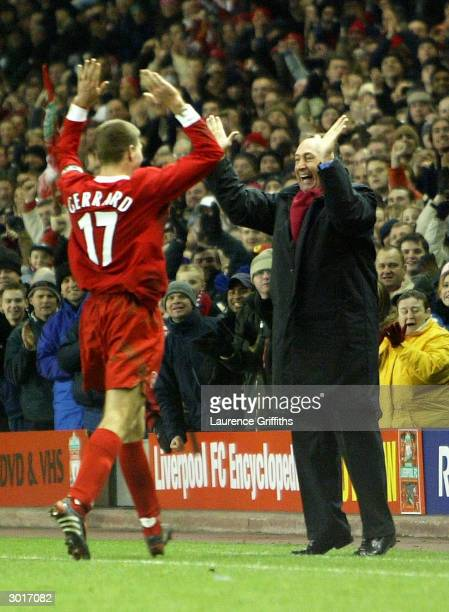 Steven Gerrard of Liverpool celebrates with manager Gerard Houllier after scoring the first goal during the UEFA Cup third round first leg match...