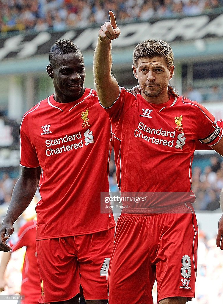 Steven Gerrard of Liverpool celebrates with Mario Balotelli after scoring from the spot during the Barclays Premier League match between Tottenham Hotspur and Liverpool at White Hart Lane on August 31, 2014 in London, England.