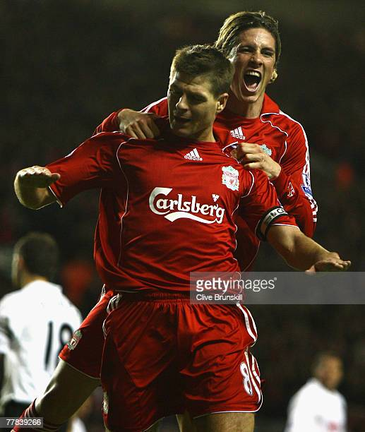 Steven Gerrard of Liverpool celebrates with team mate Fernando Torres after scoring his team's second goal during the Barclays Premier League match...