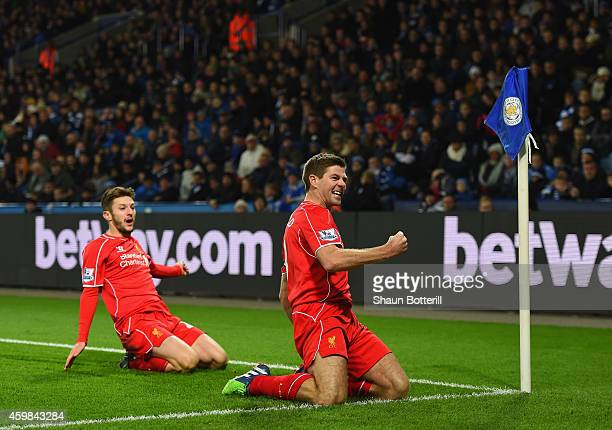 Steven Gerrard of Liverpool celebrates with teammate Adam Lallana of Liverpool after scoring his team's second goal during the Barclays Premier...
