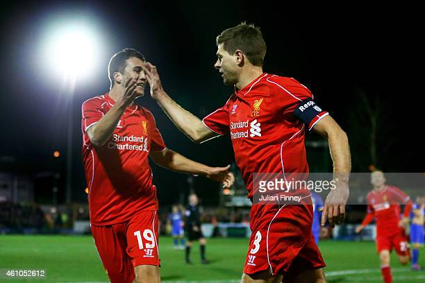 Steven Gerrard of Liverpool celebrates with teammate Javi Manquillo of Liverpool after scoring the opening goal with a header during the FA Cup Third...
