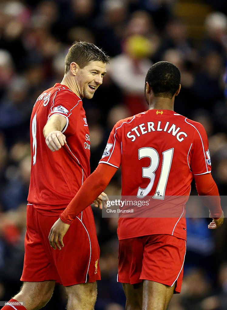 Steven Gerrard of Liverpool celebrates with teammate Raheem Sterling of Liverpool after scoring his team's second goal from the penalty spot during the Barclays Premier League match between Liverpool and Leicester City at Anfield on January 1, 2015 in Liverpool, England.