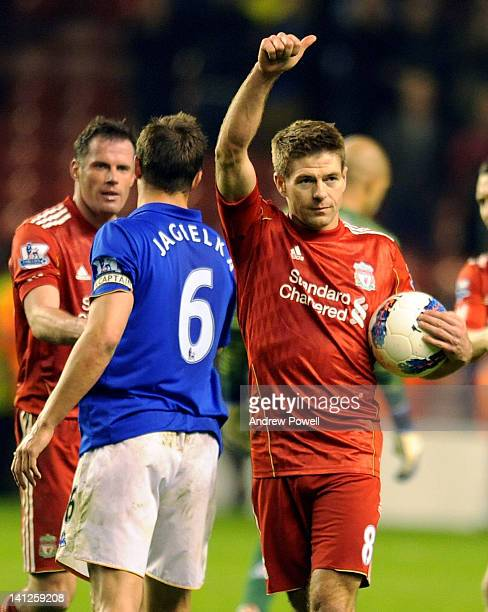 Steven Gerrard of Liverpool celebrates with the hat-trick ball at the end of the Barclays Premier League match between Liverpool and Everton at...
