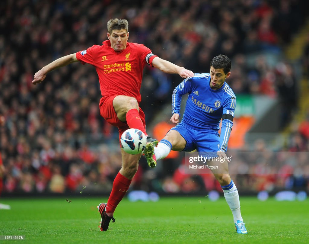 Steven Gerrard of Liverpool challenges Eden Hazard of Chelsea during the Barclays Premier League match between Liverpool and Chelsea at Anfield on April 21, 2013 in Liverpool, England.
