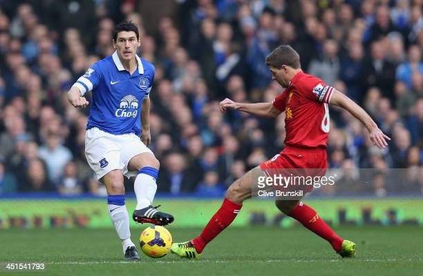 Steven Gerrard of Liverpool challenges Gareth Barry of Everton during the Barclays Premier League match between Everton and Liverpool at Goodison...