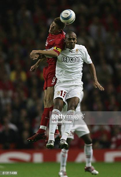 Steven Gerrard of Liverpool clashes with Douglas Maicon of Monaco during the UEFA Champions League Group A match between Liverpool and AS Monaco at...