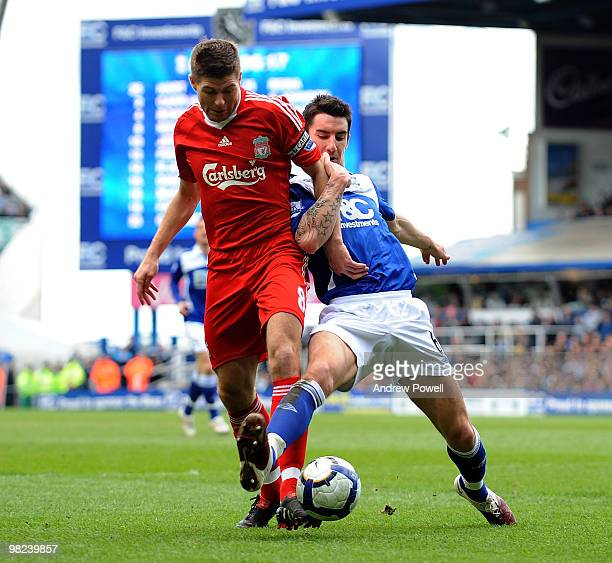 Steven Gerrard of Liverpool competes with Liam Ridgewell of Birmingham during the Barclays Premier League match between Birmingham City and Liverpool...
