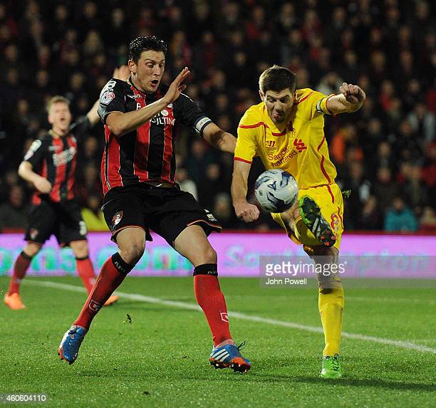 Steven Gerrard of Liverpool competes with Tommy Elphick of Bournemouth during the Capital One Cup QuarterFinal match between Bournemouth and...