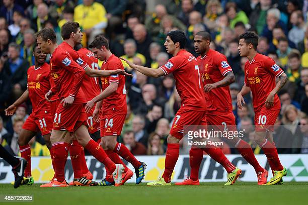 Steven Gerrard of Liverpool congratulates Luis Suarez of Liverpool on scoring their second goal during the Barclays Premier League match between...