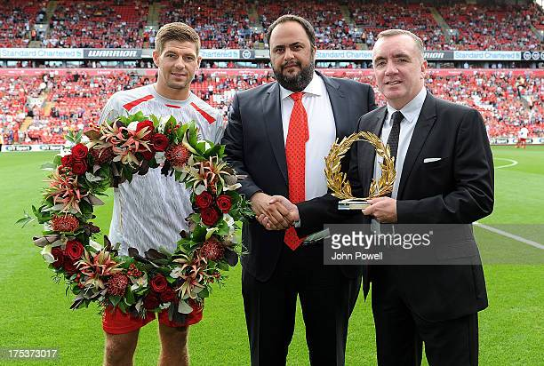 Steven Gerrard of Liverpool FC is presented with awards by Olympiacos President Evangelos M Marinakis and managing director Ian Ayre of Liverpool FC...