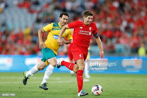 Steven Gerrard of Liverpool FC Legends lbreaks away from Tony Vidmar of Australian Legends during the match between Liverpool FC Legends and the...