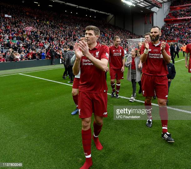 Steven Gerrard of Liverpool FC Legends showing his appreciation to the fans at the end of the friendly match between Liverpool FC Legends and AC...