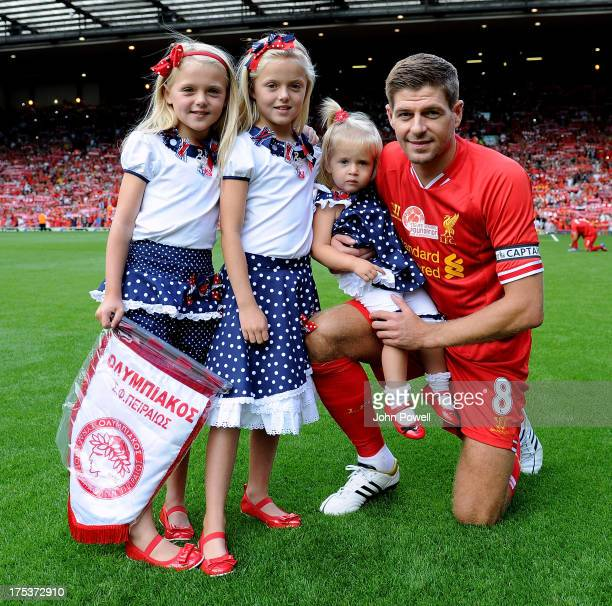 Steven Gerrard of Liverpool FC poses with his daughters before the Steven Gerrard Testimonial Match between Liverpool and Olympiacos at Anfield on...