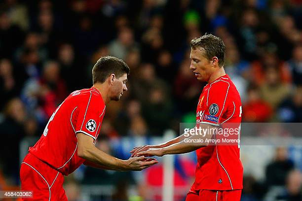 Steven Gerrard of Liverpool FC replaces team mate Lucas Leiva during the UEFA Champions League Group B match between Real Madrid CF and Liverpool FC...