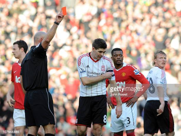 Steven Gerrard of Liverpool gets a red card during the FA Cup Sponsored by E.ON 3rd Round match between Manchester United and Liverpool at Old...