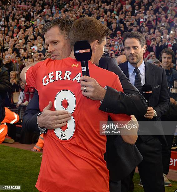 Steven Gerrard of Liverpool gives Jamie Carragher a hug at the end of the Barclays Premier League match between Liverpool and Crystal Palace at...