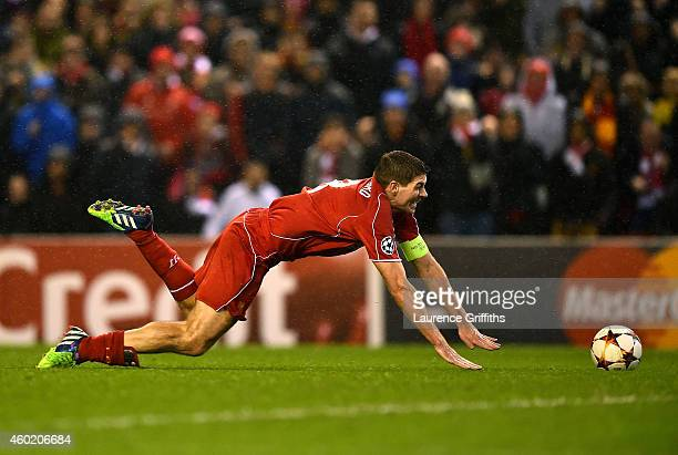Steven Gerrard of Liverpool goes down in the area during the UEFA Champions League group B match between Liverpool and FC Basel 1893 at Anfield on...