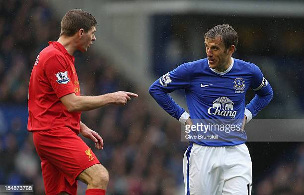 Steven Gerrard of Liverpool has words with Phil Neville of Everton during the Barclays Premier League match between Everton and Liverpool at Goodison...