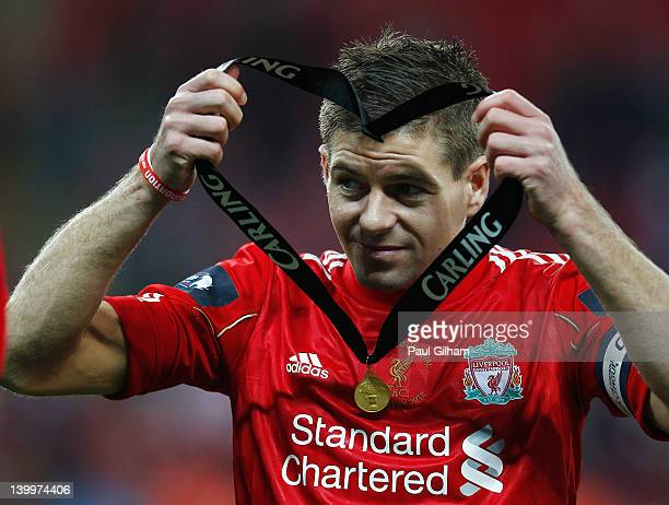 Steven Gerrard of Liverpool holds his winners medal after the Carling Cup Final match between Liverpool and Cardiff City at Wembley Stadium on...