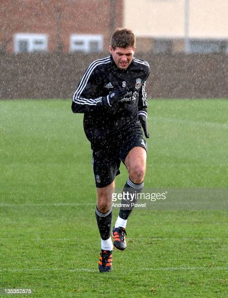 Steven Gerrard of Liverpool in action during a Liverpool training session at Melwood Training Ground on December 9 2011 in Liverpool England