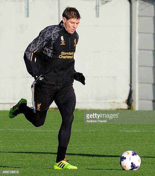 Steven Gerrard of Liverpool in action during a training session at Melwood Training Ground on December 24 2013 in Liverpool England