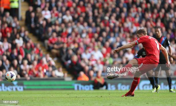 Steven Gerrard of Liverpool in scores the third goal from the penalty spot during the Barclays Premier League match between Liverpool and Crystal...