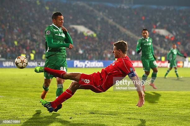 Steven Gerrard of Liverpool is challenged by Marcelinho of Ludogeretsduring the UEFA Champions League Group B match between Ludogorets Razgrad and...