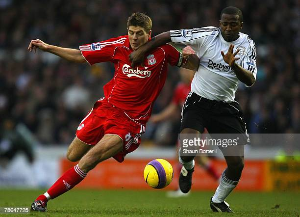 Steven Gerrard of Liverpool is challenged by Michael Johnson of Derby County during the Barclays Premier League match between Derby County and...