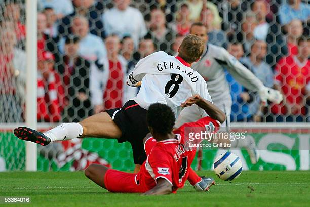 Steven Gerrard of Liverpool is fouled by Ugo Ehiogu of Middlesbrough which led to his sending off during the Barclays Premiership match between...