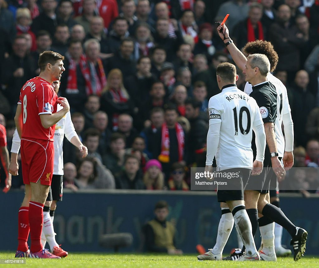 Steven Gerrard of Liverpool is sent off by referee Martin Atkinson during the Barclays Premier League match between Liverpool and Manchester United at Anfield on March 22, 2015 in Liverpool, England.