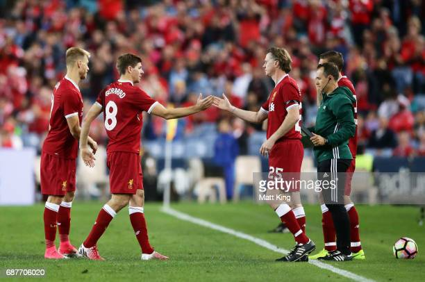 Steven Gerrard of Liverpool is substituted by Steve McManaman of Liverpool during the International Friendly match between Sydney FC and Liverpool FC...