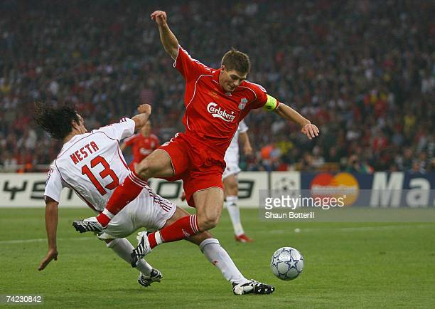 Steven Gerrard of Liverpool is tackled by Alessandro Nesta of Milan during the UEFA Champions League Final match between Liverpool and AC Milan at...