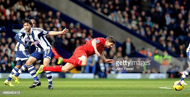 Steven Gerrard of Liverpool is tackled by Calaudio Yacob of West Bromwich Albion during the Barclays Premier Leauge match between West Bromwich...