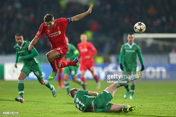 Steven Gerrard of Liverpool is tackled by Cosmin Moti of Ludogerets during the UEFA Champions League Group B match between Ludogorets Razgrad and...