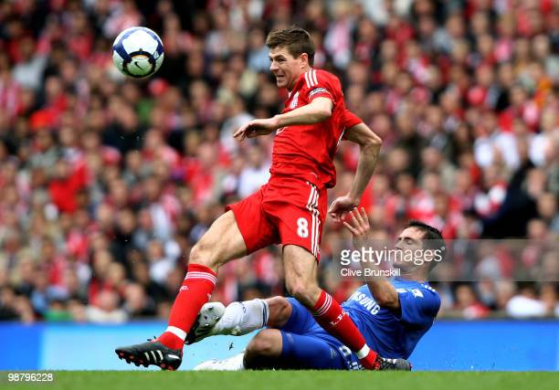 Steven Gerrard of Liverpool is tackled by Frank Lampard of Chelsea during the Barclays Premier League match between Liverpool and Chelsea at Anfield...
