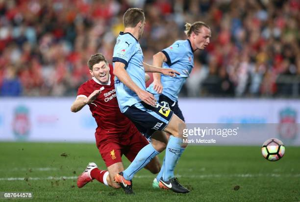 Steven Gerrard of Liverpool is tackled in the penalty box during the International Friendly match between Sydney FC and Liverpool FC at ANZ Stadium...