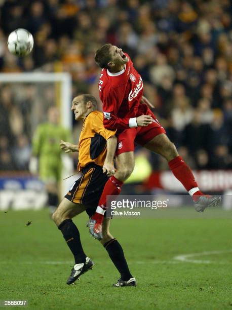 Steven Gerrard of Liverpool jumps for the ball with Alex Rae of Wolverhampton Wanderers during the FA Barclaycard Premiership match between...