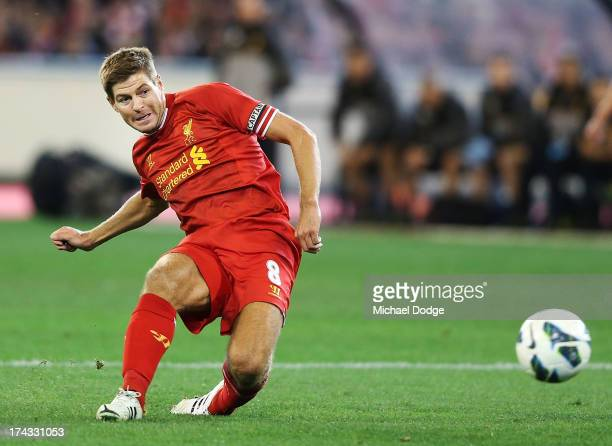 Steven Gerrard of Liverpool kicks the ball for a goal during the match between the Melbourne Victory and Liverpool at Melbourne Cricket Ground on...